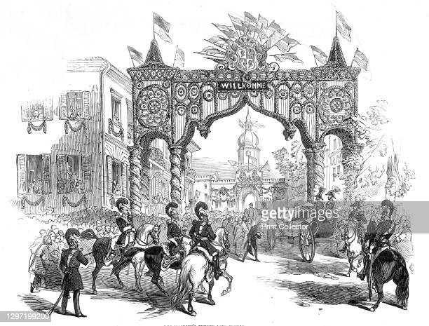Her Majesty's Entrée in to Coburg, 1845. Royal visit to Germany: crowds line the streets as Queen Victoria and Prince Albert pass under a triumphal...