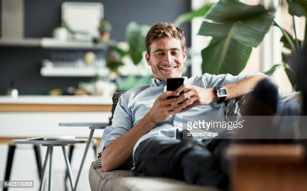 her messages always make him smile - sofa stock pictures, royalty-free photos & images