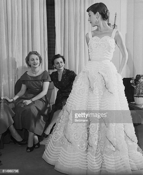 Her pleasure's showingMargaret Truman's face lights up perhaps picturing herself in this breathtaking white evening gown as she attends a special...