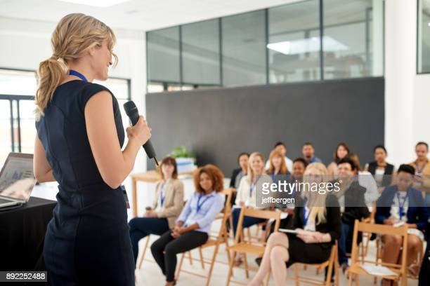 her presentation leaves an impact on her colleagues - conference stock pictures, royalty-free photos & images
