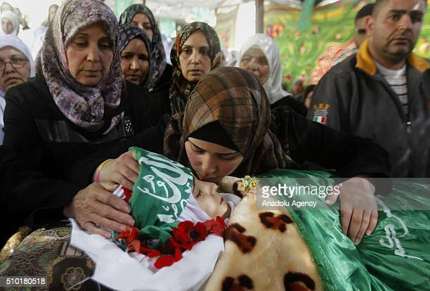 Her relatives mourn around the body of 17yearold Palestinian girl Kalzar ElUveivi who has been killed by Israeli soldiers in alleged knife attack...
