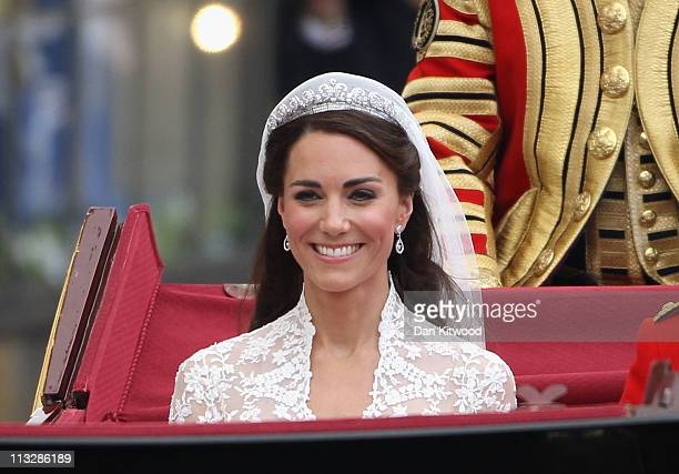 Her Royal Highness Catherine Duchess of Cambridge journeys by carriage procession to Buckingham Palace following her marriage to Prince William Duke...