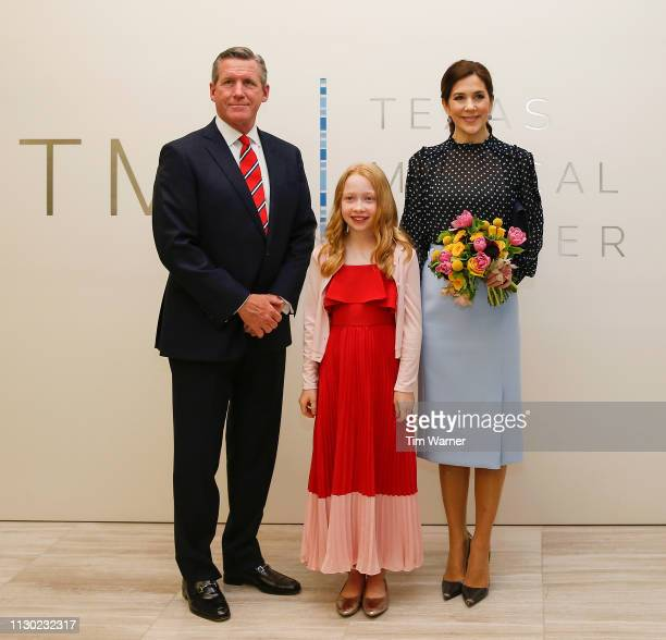 Her Royal Highness Crown Princess Mary of Denmark receives flowers from a flower girl before an event highlighting an exploration of life science...