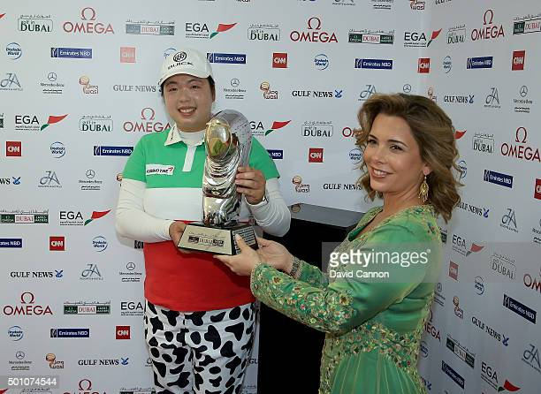 Her Royal Highness Princess Haya presents Shanshan Feng of China with the trophy after her victory in the final round of the 2015 Omega Dubai Ladies...