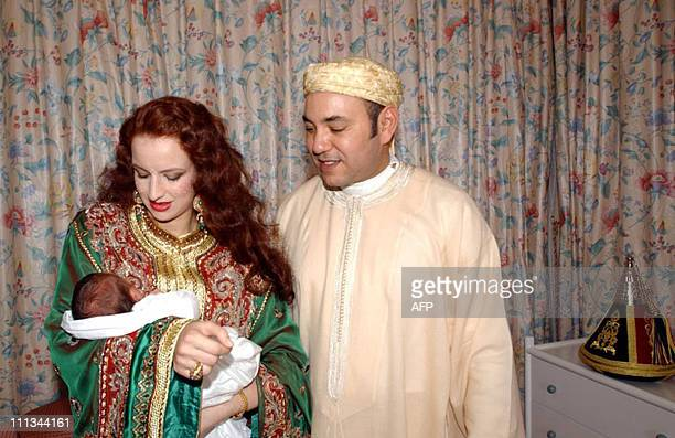 Her Royal Higness Princess Lalla Salma holds the newborn Crown Prince Moulay Hassan as his father Moroccan King Mohammed VI looks on at the royal...