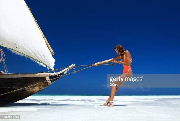 her seaside workout - zanzibar island stock photos and pictures