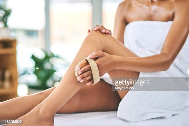 her secret to silky smooth legs - the human body stock pictures, royalty-free photos & images