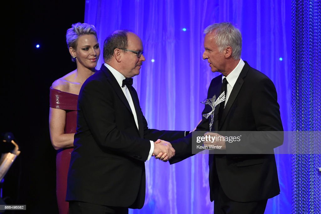Her Serene Highness Princess Charlene of Monaco, His Serene Highness Prince Albert II of Monaco, and James Cameron onostage at the 2017 Princess Grace Awards Gala at The Beverly Hilton Hotel on October 25, 2017 in Beverly Hills, California.