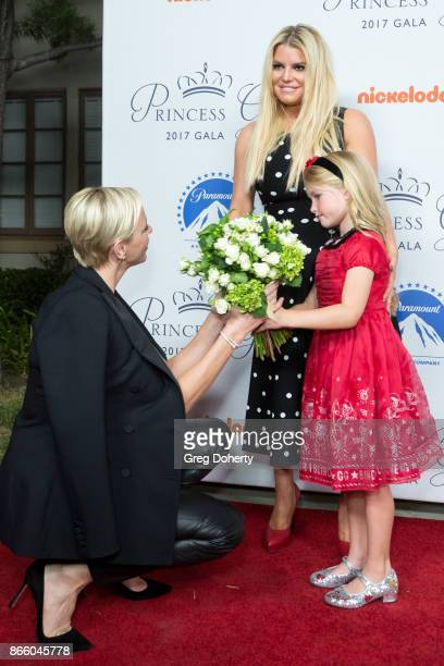 Her Serene Highness Princess Charlene of Monaco is greeted with flowers by Maxwell Johnson and Jessica Simpson at the 2017 Princess Grace Awards Gala...