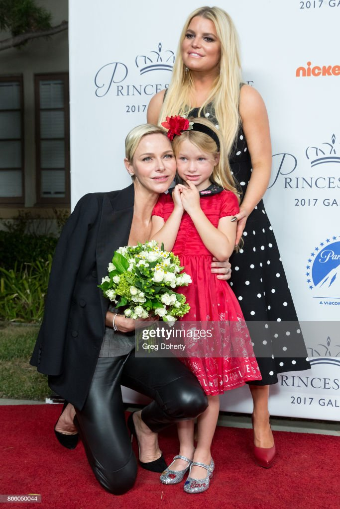 Her Serene Highness Princess Charlene of Monaco is greeted with flowers by Maxwell Johnson and Jessica Simpson at the 2017 Princess Grace Awards Gala Kick Off Event at Paramount Pictures on October 24, 2017 in Los Angeles, California.