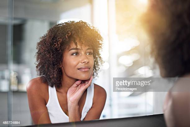 her skin's as perfect as ever - looking stock pictures, royalty-free photos & images