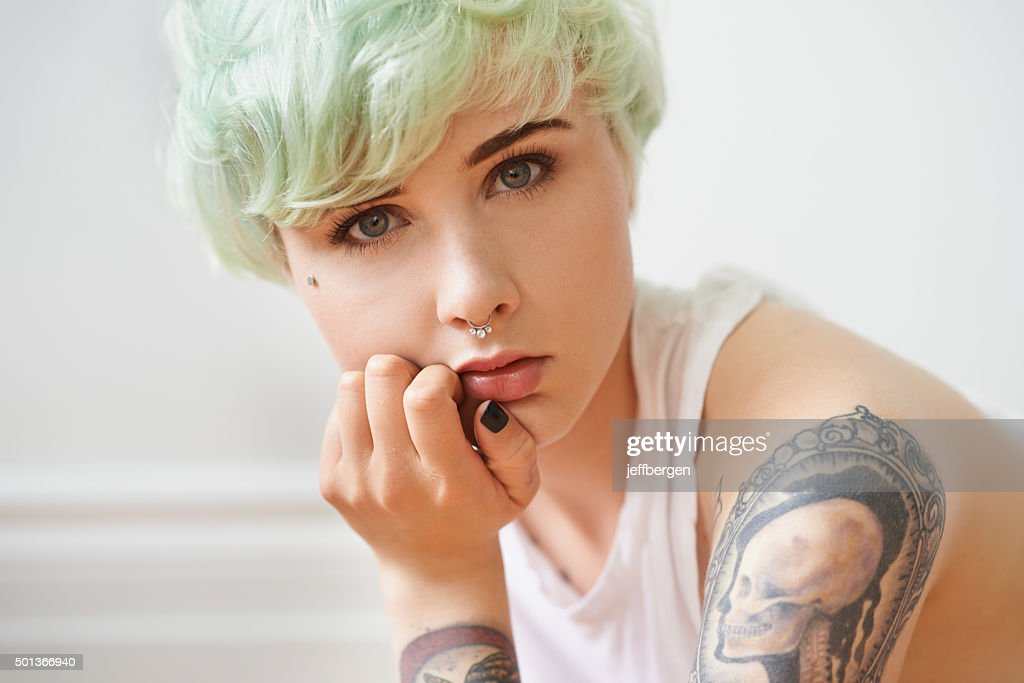 Her tattoos are more than just skin deep : Stock Photo
