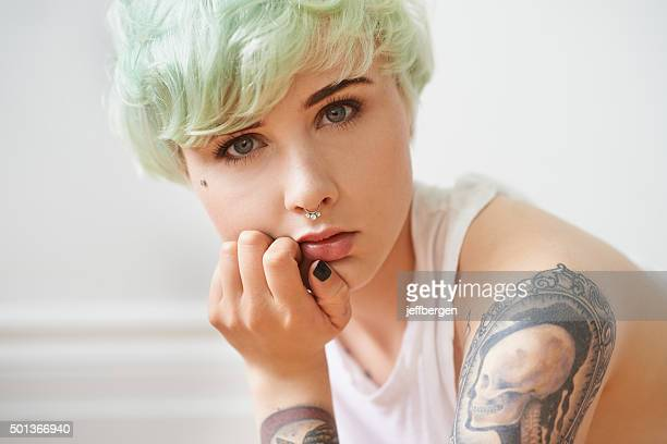 her tattoos are more than just skin deep - emo stock photos and pictures
