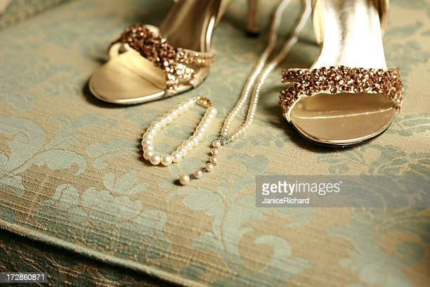 her wedding things - gold shoe stock photos and pictures