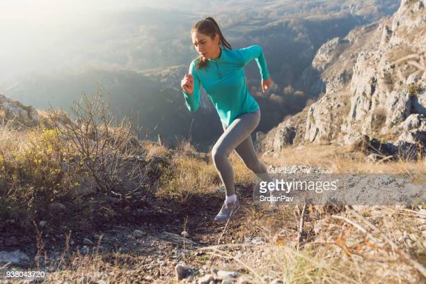 her will is stronger than fatigue - cross country running stock pictures, royalty-free photos & images
