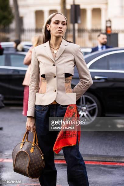Hera Pradel wearing a beige cropped blazer blue jeans Louis Vuitton scarf and bag is seen outside Rokh during Paris Fashion Week Womenswear...