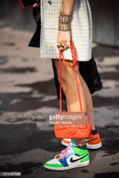 Hera Pradel, wearing a teal Chanel dress, colorful Nike sneakers and red Chanel bag, is seen outside Chanel, during Paris Fashion Week - Womenswear...