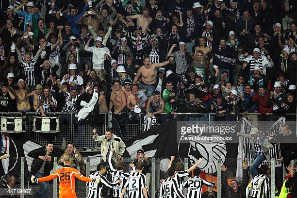 Heracles players celebrate victory in front of the fans after the Dutch Cup semi final match between AZ Alkmaar and SC Heracles Almelo at AFAS...