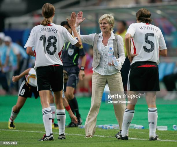 Herad coach Silvia Neid congratulates Kerstin Garefrekes after her goal during the Quarter Final Womens World Cup 2007 match between Germany and...