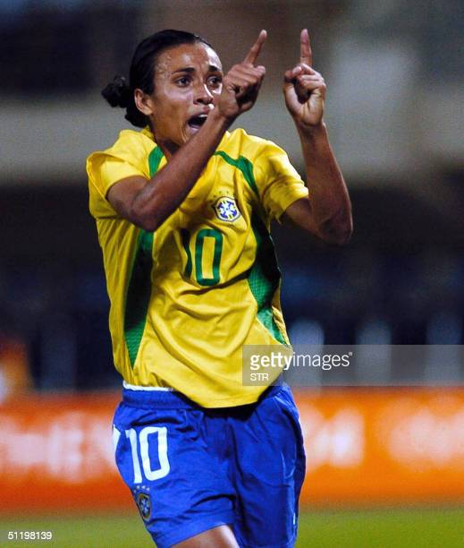 Brazil's Marta reacts after scoring aginst Mexico during their Olympic Games women's football quater final match 20 August 2004 in Heraklion AFP...