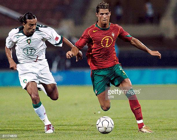Heraklion , GREECE: Portugal's Cristiano Ronaldo fights for the ball with Moroccan Otmane El Assas during their group D match at the Pankritio...