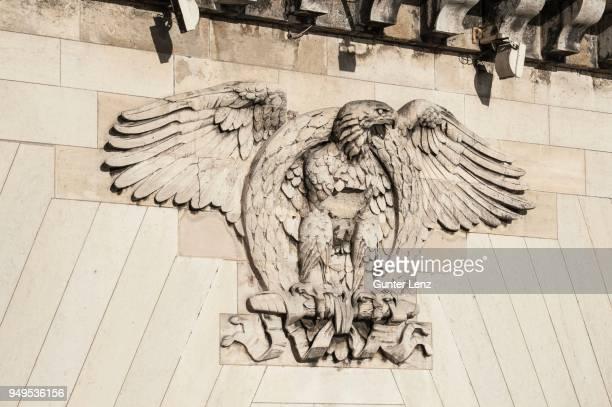 Heraldic animal eagle with a laurel wreath, relief on bridge, Pont Neuf, Paris, France