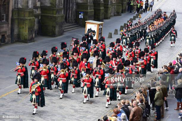 Heralds escorted by a military band and guard of honour march to the Mercat Cross on Edinburgh's Royal Mile for the reading of a royal proclamation...