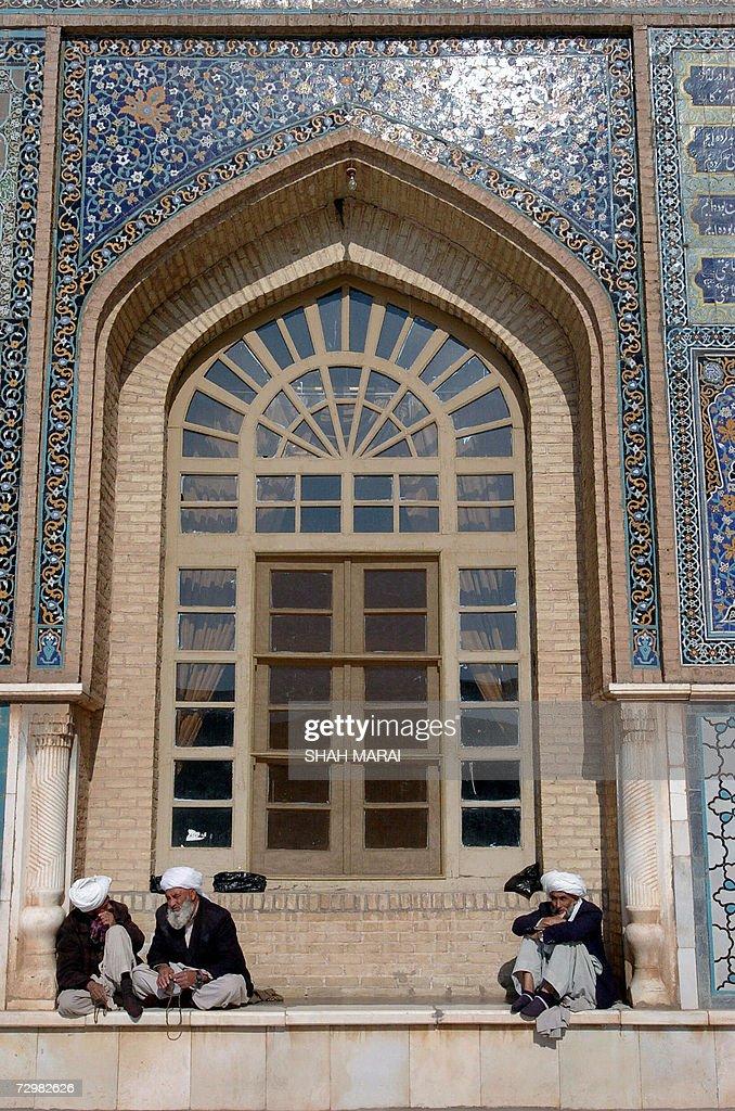 Afghan men sit by the Masjid-i Jami mosq : News Photo