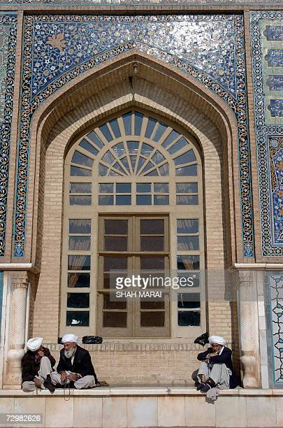 Afghan men sit by the Masjidi Jami mosque in Herat 12 January 2007 Masjidi Jami this 800yearold city's first congregational mosque was built on the...