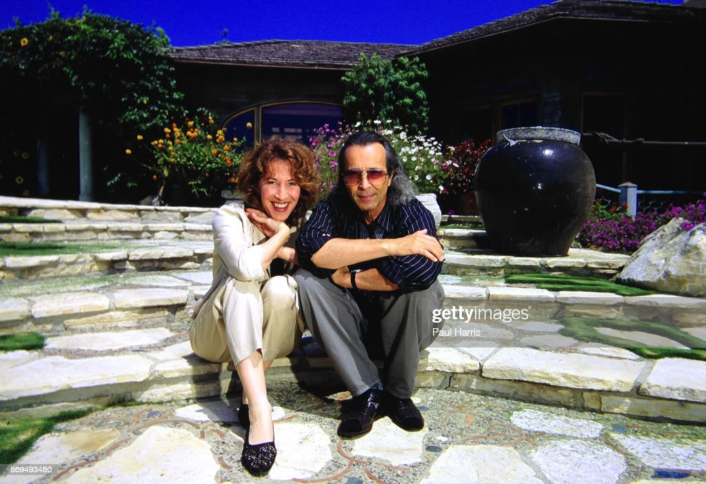 Herb Alpert 47 founder of the Tijuana Brass and A&M records with his wife Lani in the garden of the Malibu home he has lived in since 1974 which is on a cliff overlooking the Pacific Ocean. May 12, 1982 in the back garden, El Pescador, Malibu, California