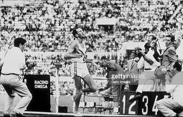 Herb Elliott of Australia finishes the 1500 meters final at the 1960 Olympic Games in Rome in a world record time of 3 minutes 356 secondsItaly...