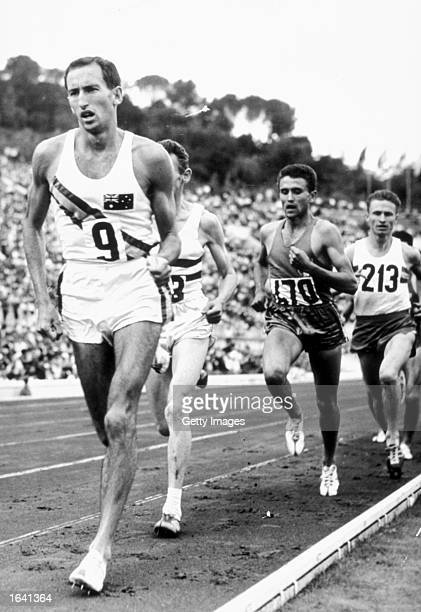 Herb Elliott of Australia leads Istvan Rozsavolgyi of Hungary, Michel Jazy of France and Zoltan Vamos of Romania in the 1500 meters final at the 1960...