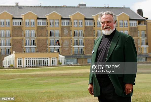 Herb Kohler poses in front of his Old Course Hotel during the third round of the 134th Open Championship at Old Course St Andrews Golf Links July 16...