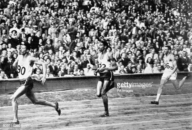 Herb McKenley of Jamaica centre is seen leading the men's Olympic Games 400 metres final at Wembley London followed by the eventual winner Arthur...