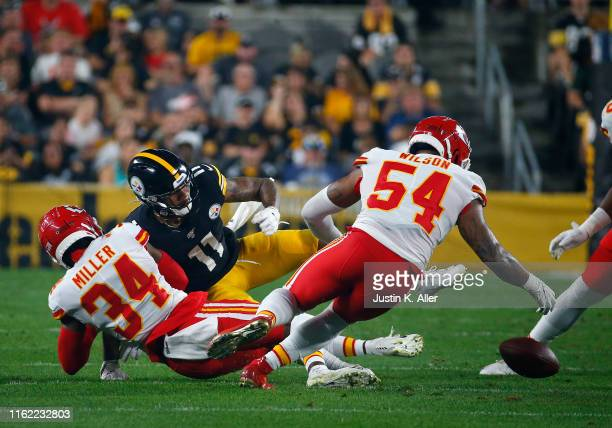 Herb Miller of the Kansas City Chiefs strips the ball from Donte Moncrief of the Pittsburgh Steelers in the first half during a preseason game at...