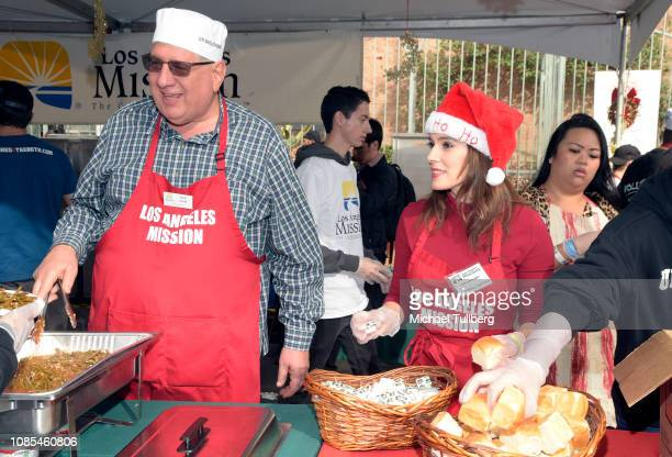 Herb Smith and Christina DeRosa serve up food at the annual Los Angeles Mission Christmas at Los Angeles Mission on December 21 2018 in Los Angeles...