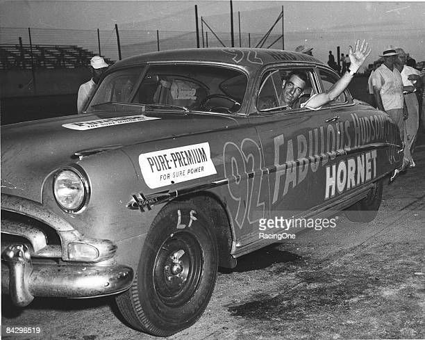 Herb Thomas waves from the window of his Fabulous Hudson Hornet after battling in another NASCAR event