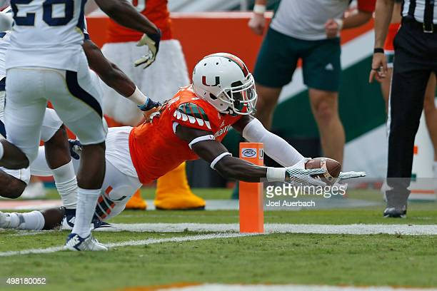 Herb Waters of the Miami Hurricanes reaches out with the ball to score a touchdown against the Georgia Tech Yellow Jackets on November 21 2015 at Sun...