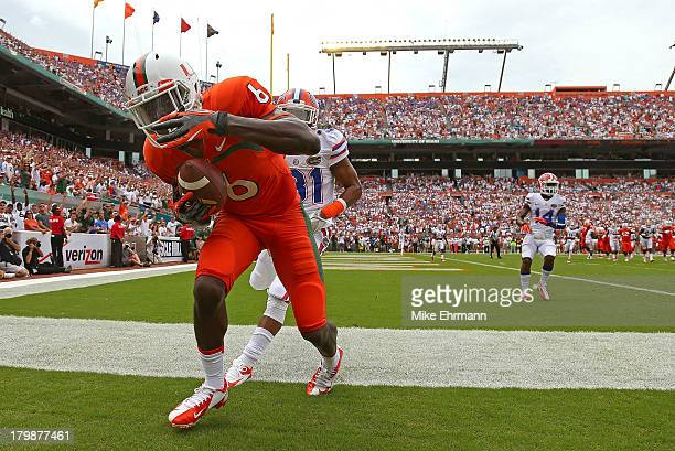 Herb Waters of the Miami Hurricanes scores a touchdown during a game against the Florida Gators at Sun Life Stadium on September 7 2013 in Miami...