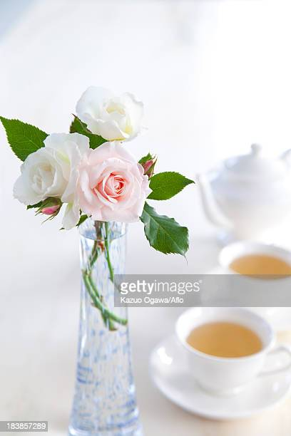 Herbal tea and a roses in a vase