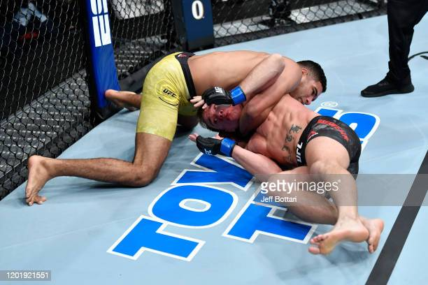 Herbert Burns of Brazil attempts to submit Nate Landwehr in their featherweight bout during the UFC Fight Night event at PNC Arena on January 25 2020...