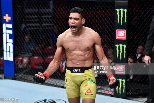 Herbert Burns of Brazil celebrates his victory over Nate Landwehr in their featherweight bout during the UFC Fight Night event at PNC Arena on...