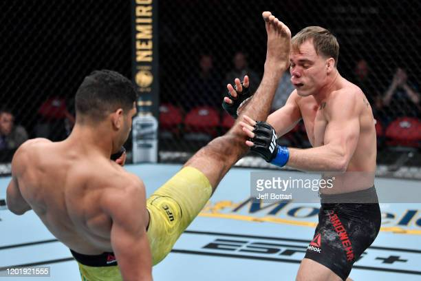 Herbert Burns of Brazil kicks Nate Landwehr in their featherweight bout during the UFC Fight Night event at PNC Arena on January 25 2020 in Raleigh...