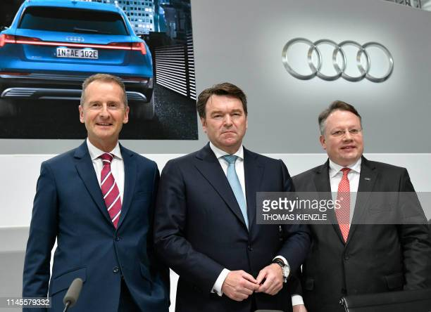Herbert Diess chairman of the supervisory board of German car maker Audi Bram Schot Dutch CEO of Audi and CFO Alexander Seitz attend the company's...