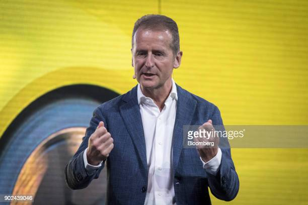 Herbert Diess chief of the Volkswagen AG brand right speaks during an event at the 2018 Consumer Electronics Show in Las Vegas Nevada US on Sunday...