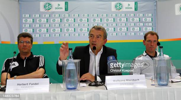 Herbert Fandel chairman of the German referee committee Wolfgang Niersbach president of the German Football Association and Florian Meyer referee...