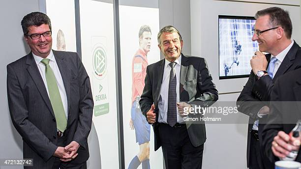 Herbert Fandel DFB President Wolfgang Niersbach and DEKRA CEO Stefan Koelbl smile during the contract renewal between DFB and DEKRA at DFB...