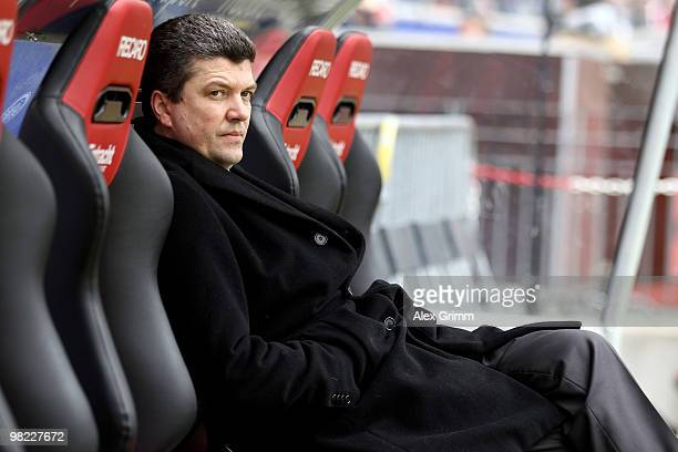 Herbert Fandel former FIFA referee and upcoming referee supervisor of the DFB sits on the substitution bench before the Bundesliga match between...