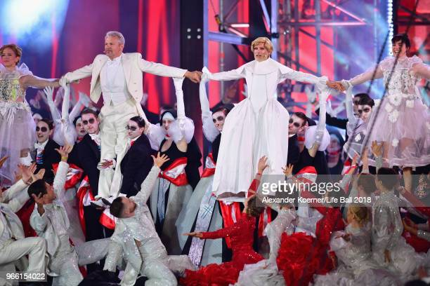 Herbert Foettinger and Conchita Wurst perform on stage during the Life Ball 2018 show at City Hall on June 2 2018 in Vienna Austria The Life Ball an...