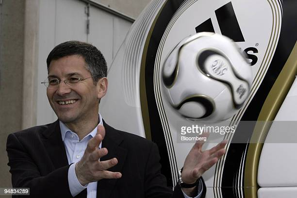 Herbert Hainer AdidasSalomon AG chief executive officer juggles a football at their annual press conference in Herzogenaurach Germany Thursday March...